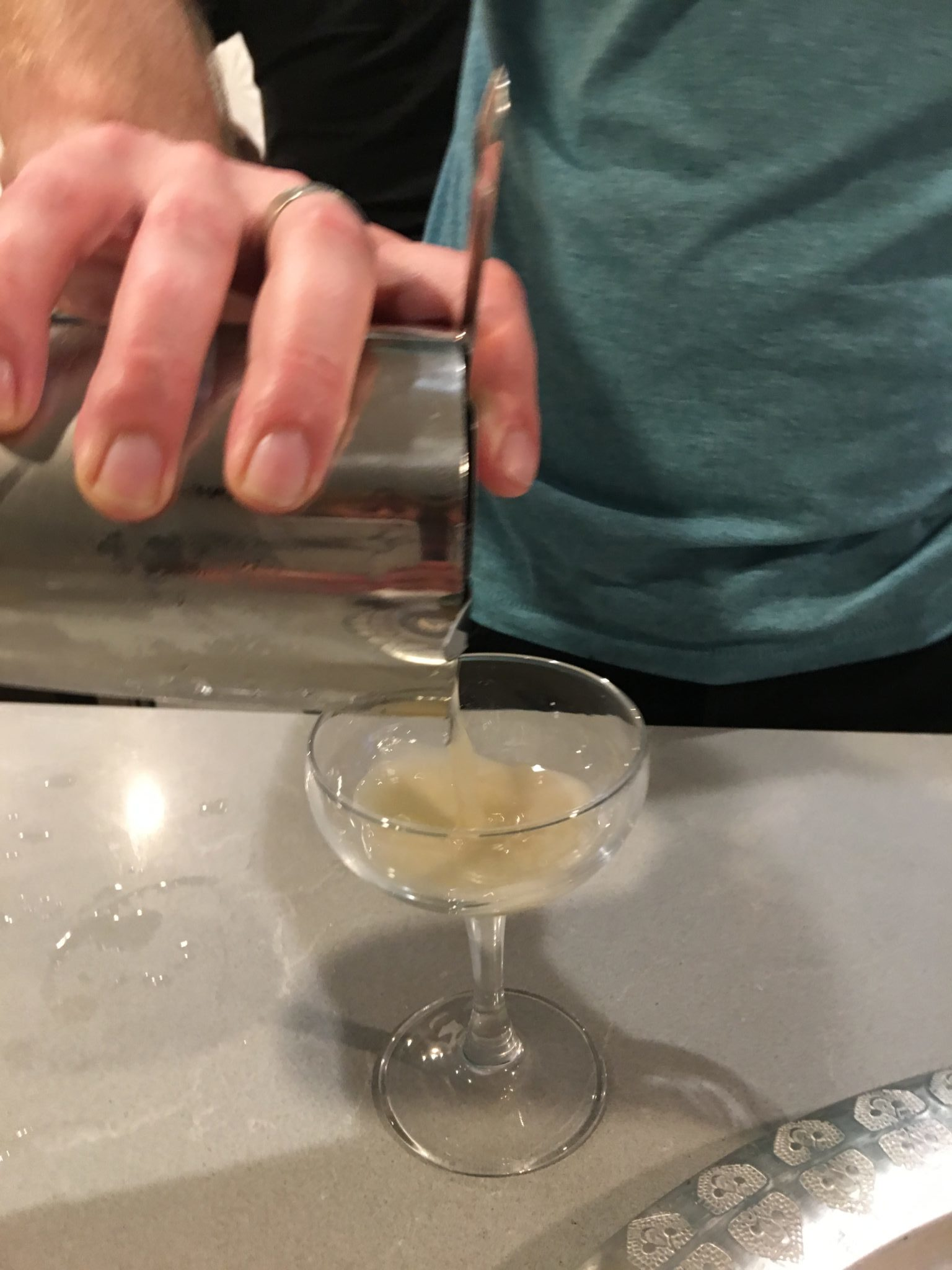 Pouring a cocktail into a glass
