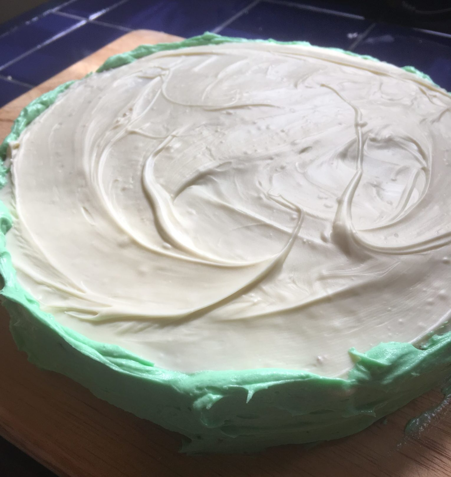 Green icing and white chocolate form the rind of the watermelon cake