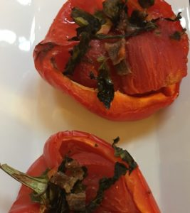 Tomatoes in roasted red peppers with basil and anchovies