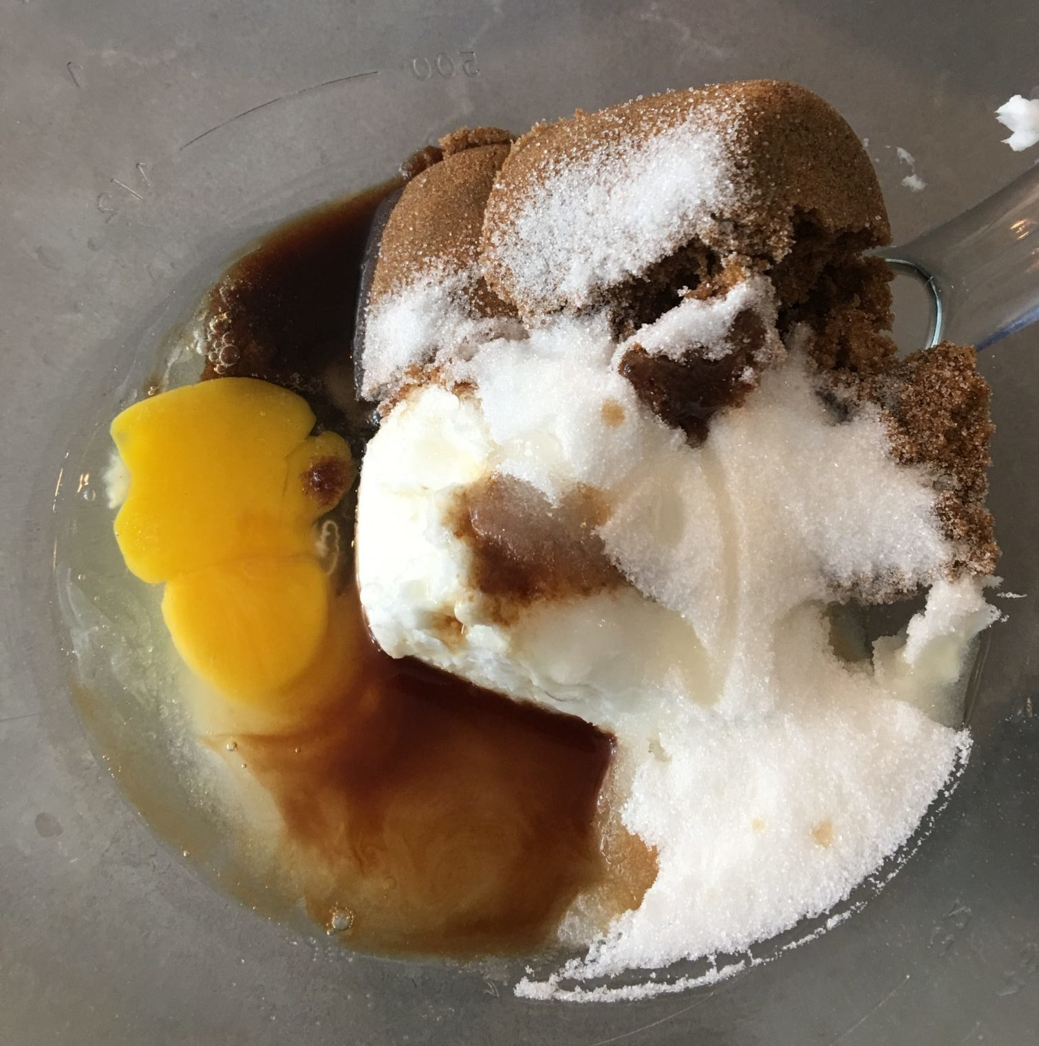 Eggs, sugar and oil in a bowl