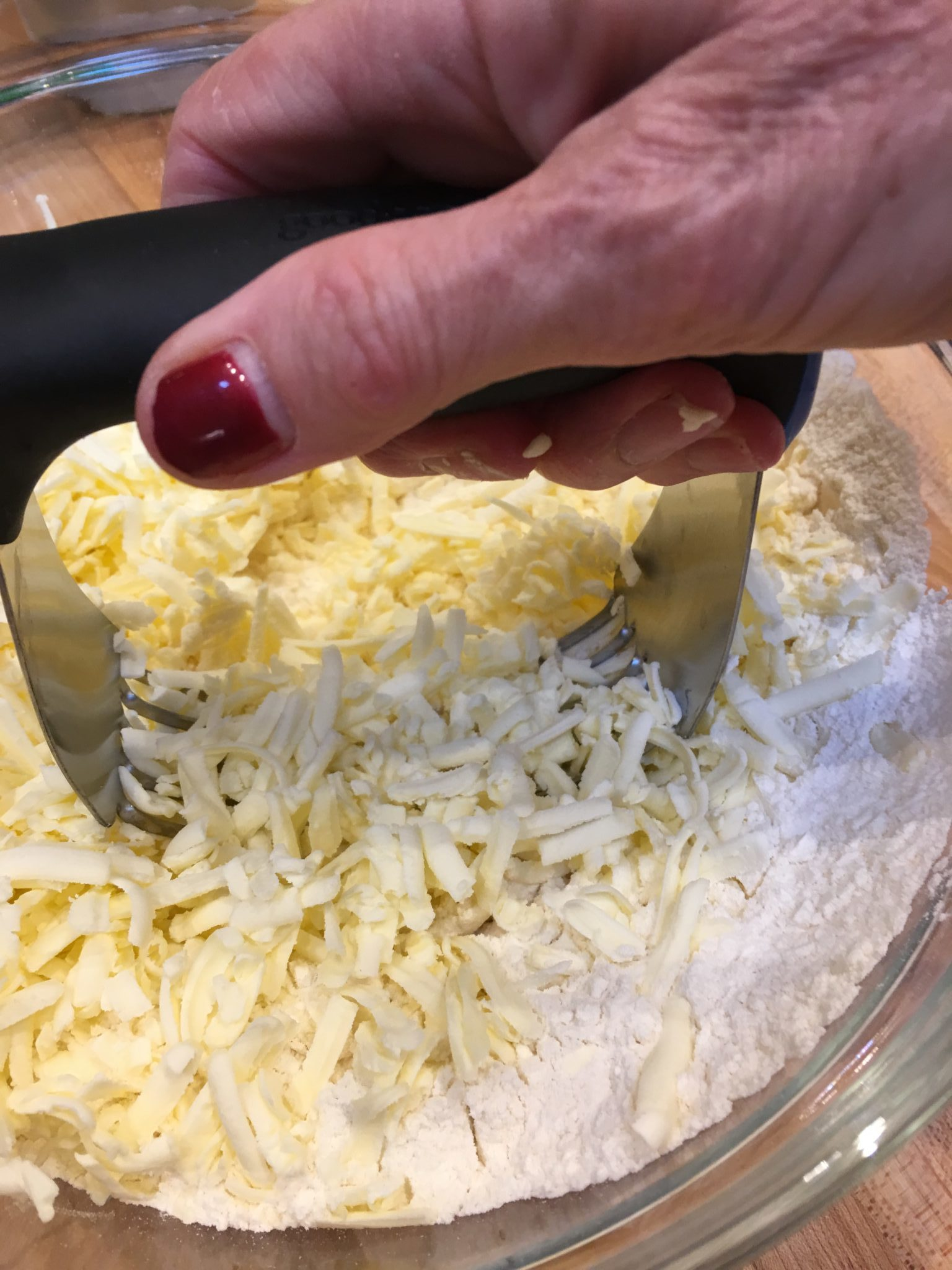 Making pastry by cutting butter into flour