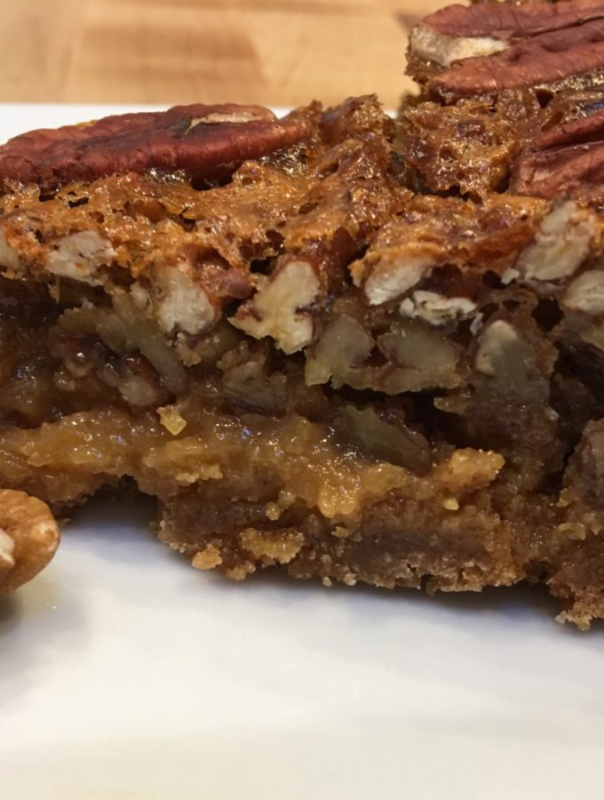 Pecan pie on a white plate