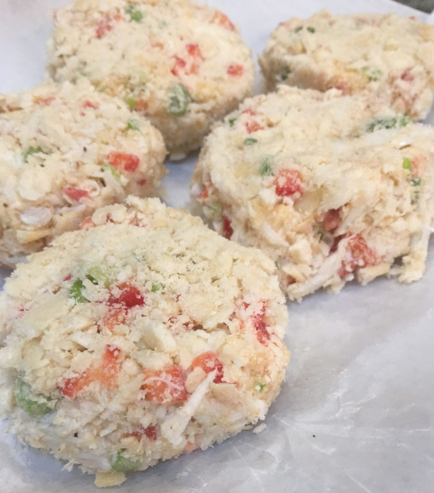 Prepared crab cakes ready to cook