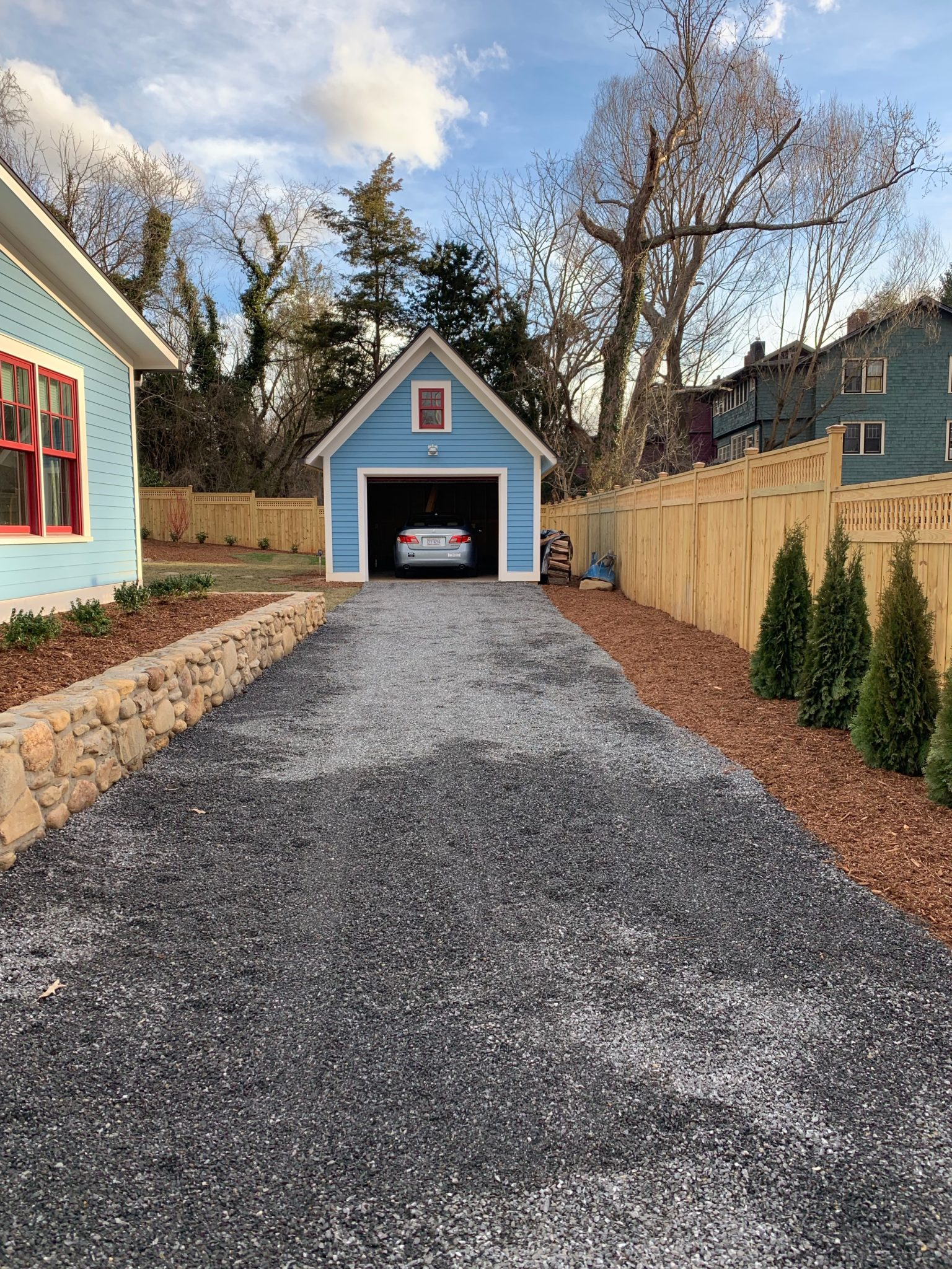 Blue garage with car