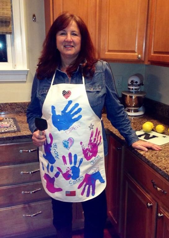 Woman wearing Apron with Handprints