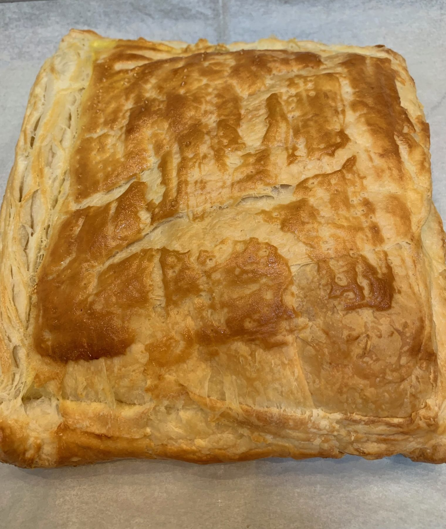 Cooked rough puff pastry square