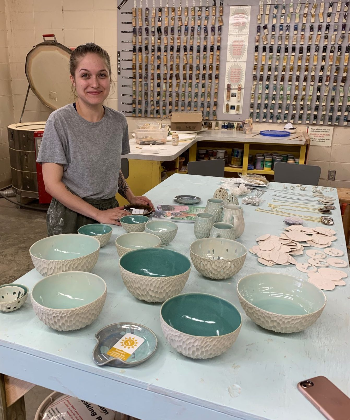 Female potter showing her work