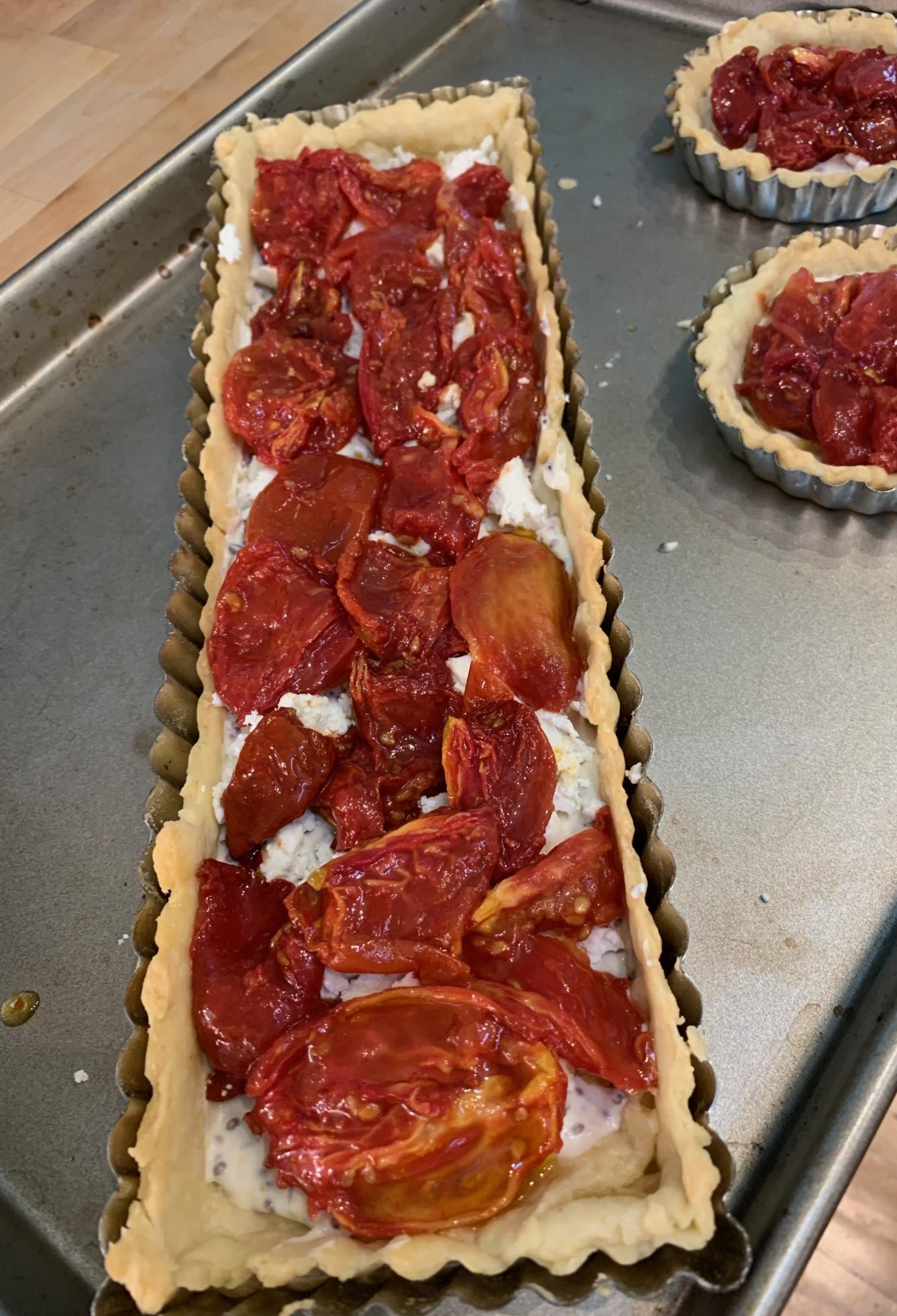 Oven-dried tomates are layered on top of the tarts
