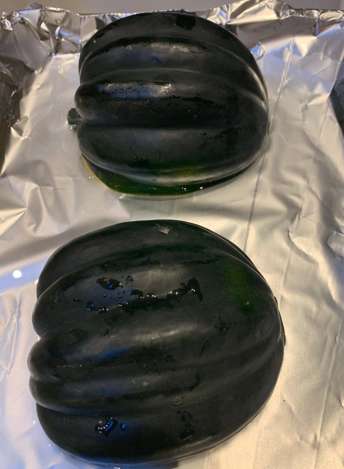 Acorn squash in water for roasting