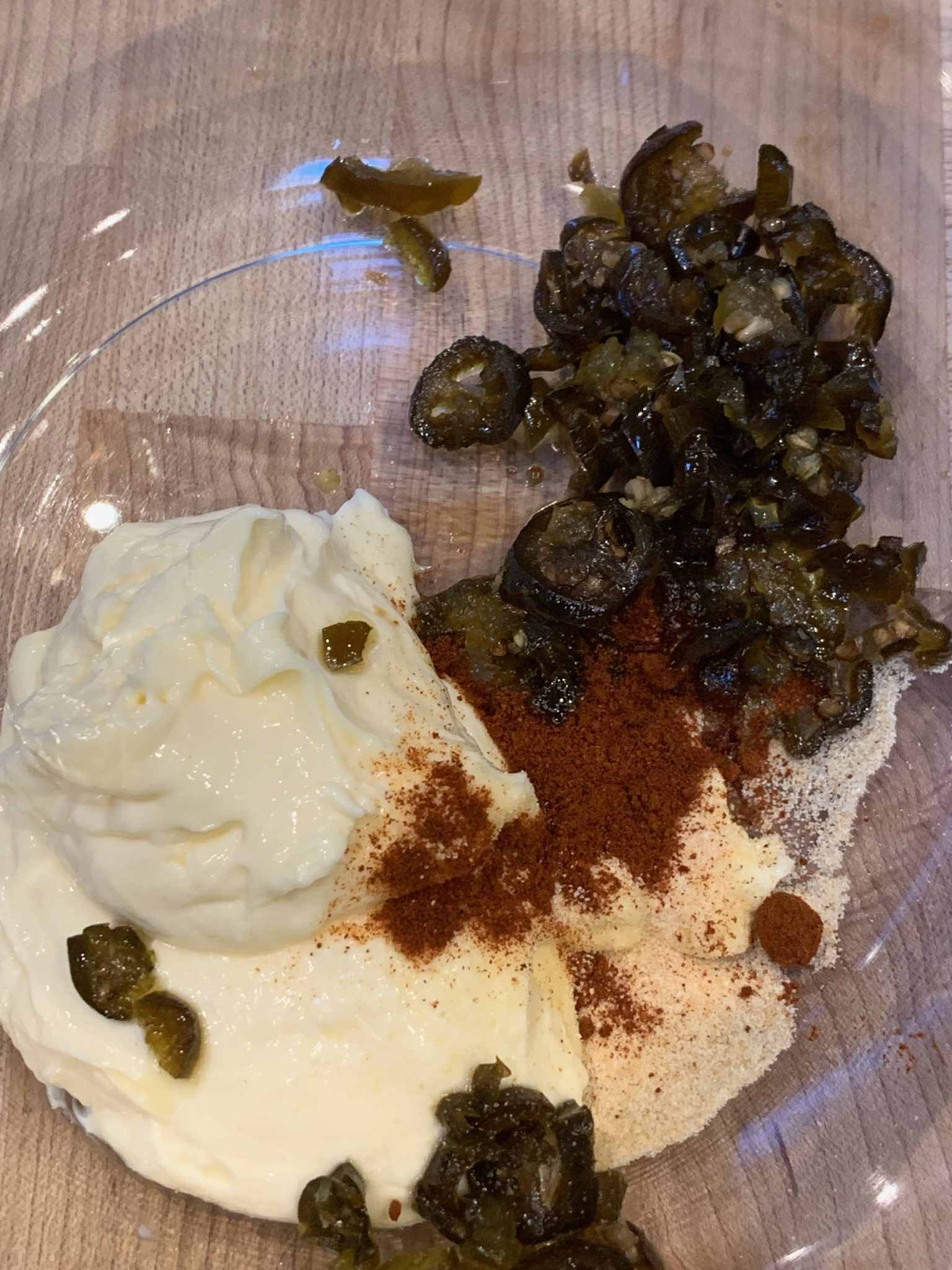 Jalapenos, mayonnaise and spices for Jalapeno Cheese in a glass bowl