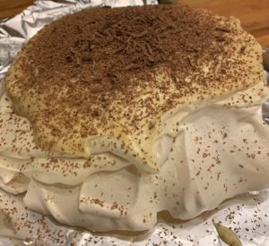 Finished single layer Pavlova with Baileys Whipped Custard and Chocolate