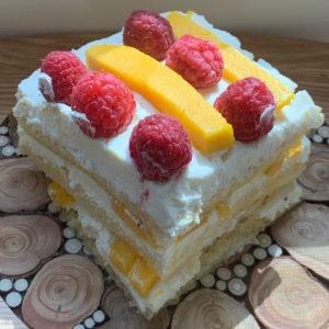 A slice of Mango Passion Fruit Tiramisu cake