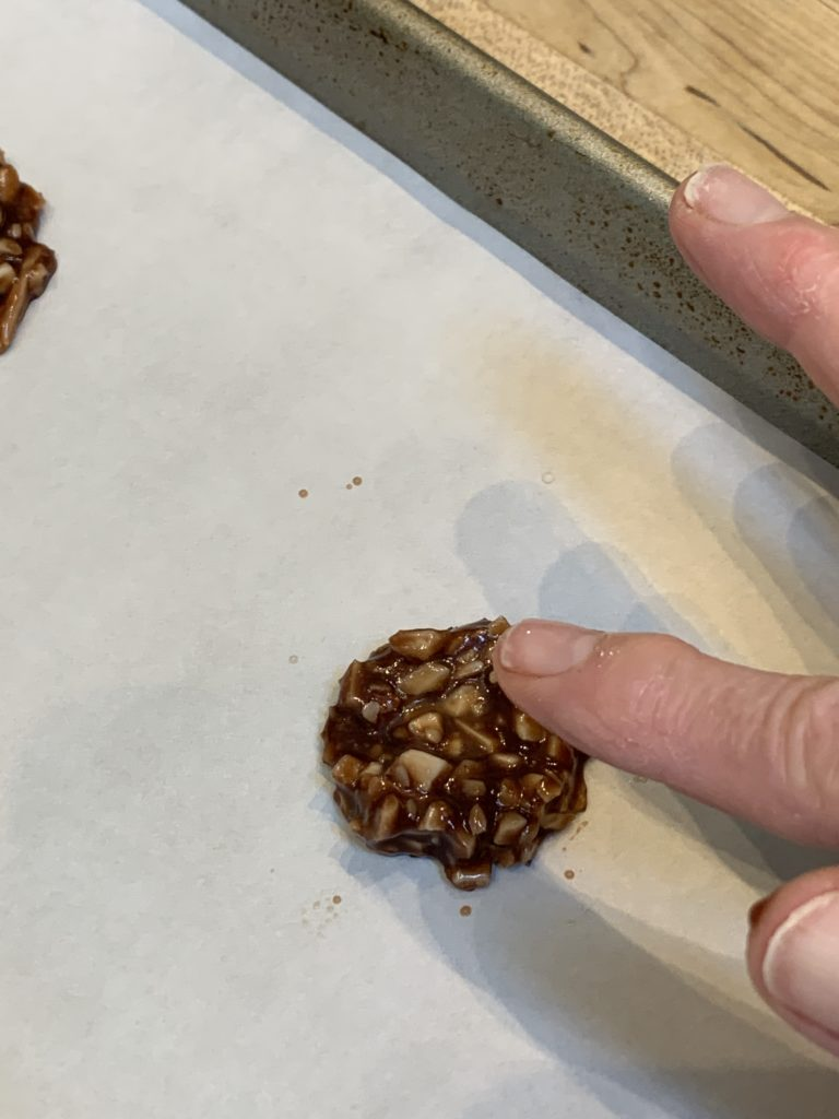 Use a wet finger to shape the Florentine cookies