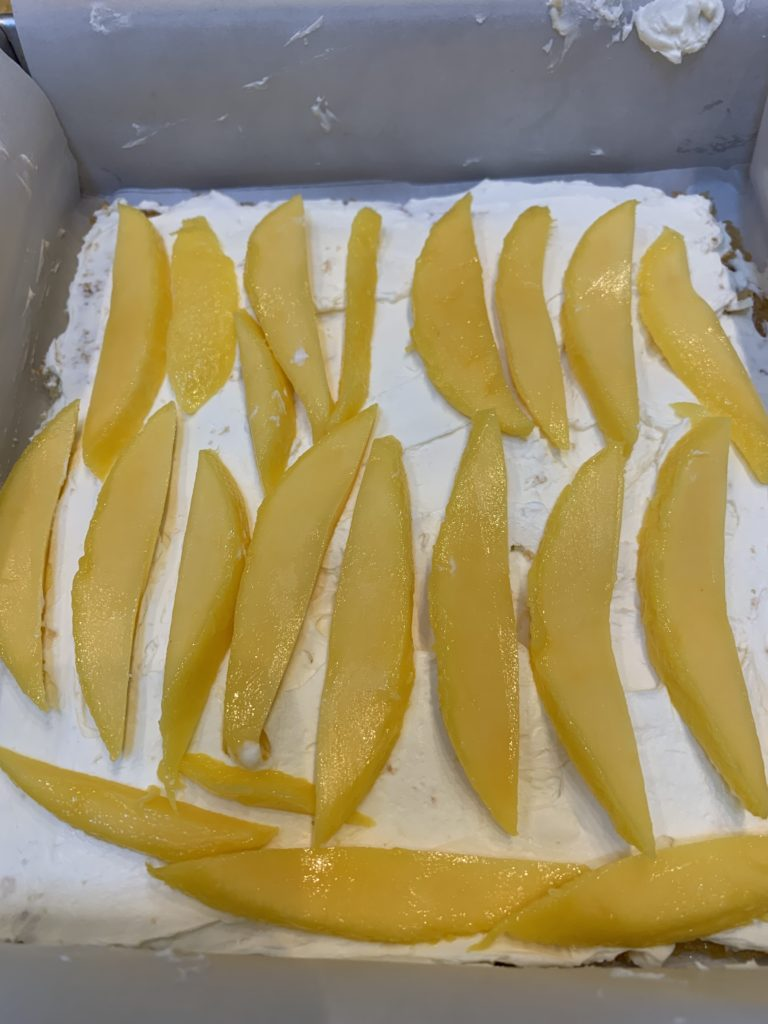 Mango layered onto a tiramisu