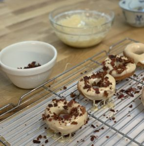 Maple glaed donuts are sprinkled with crispy bacon bits