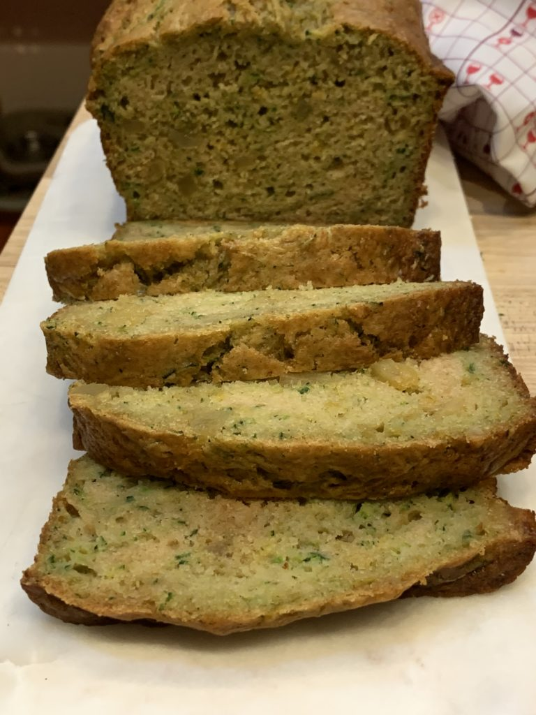Showing the small bits of zucchini in the bread