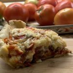Showing the layered tomatoes in a slice of Pimento Cheese Tomato Pie