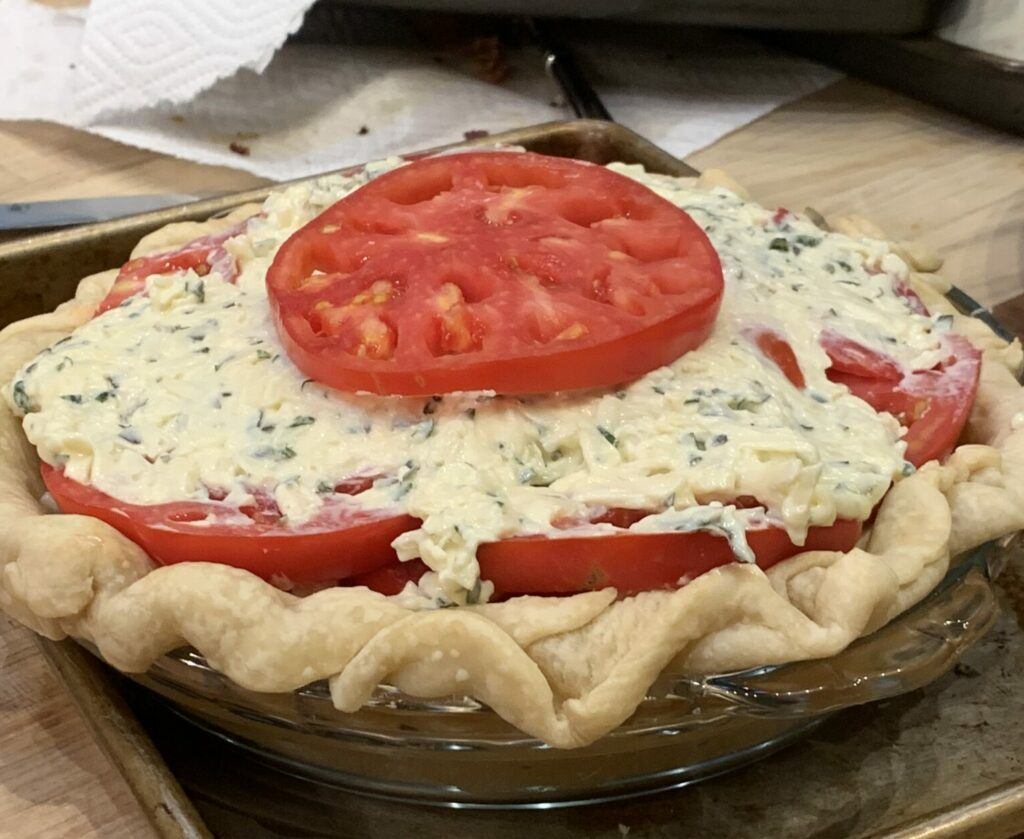 A tomato pie ready for the oven
