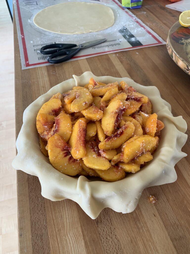 The insides of a peach pie