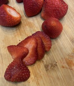 Thinly slice strawberries