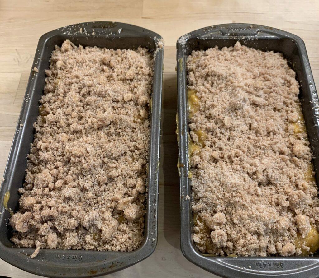 Two loaf pans of apple, pumkin, spice bread