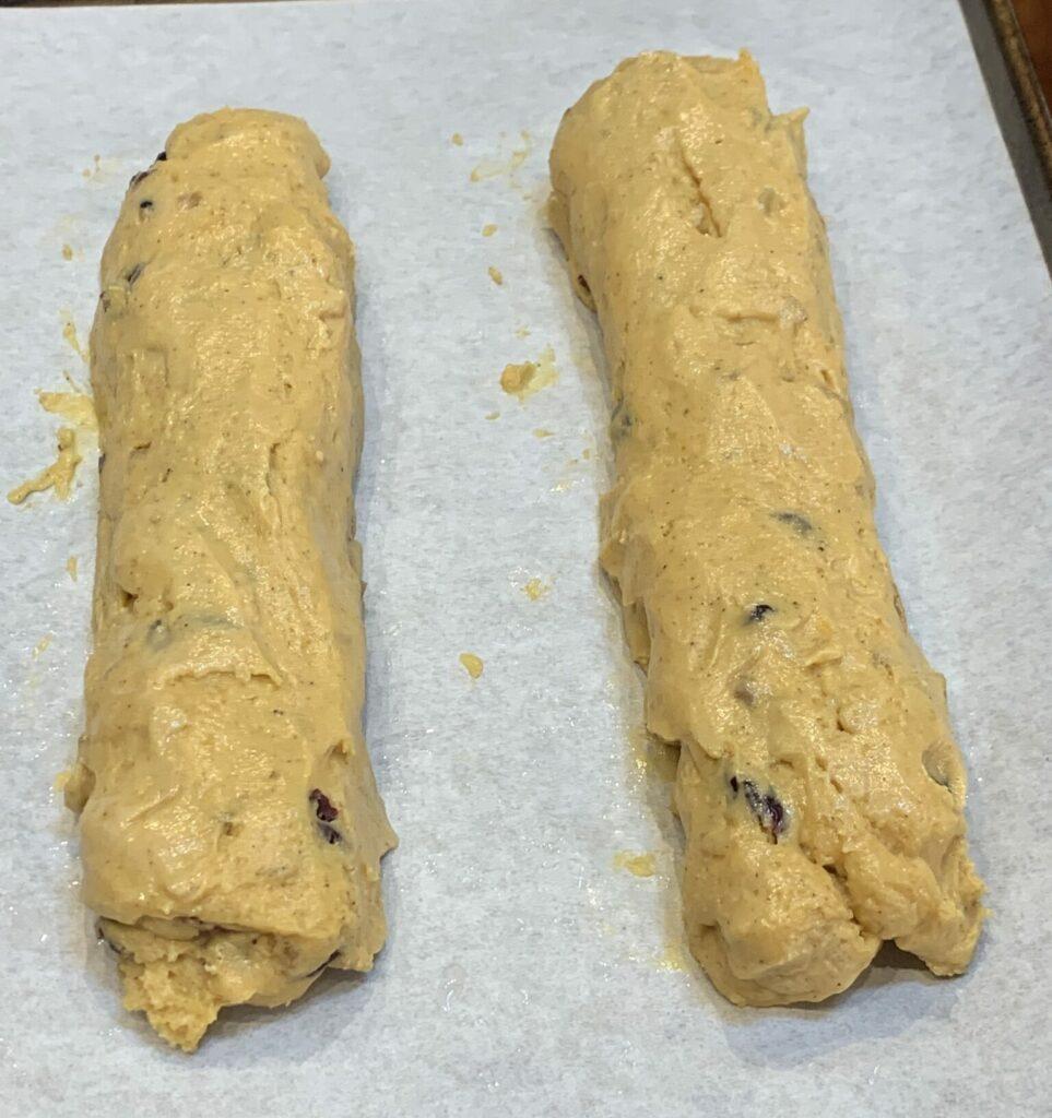 Wet hands will help form the dough
